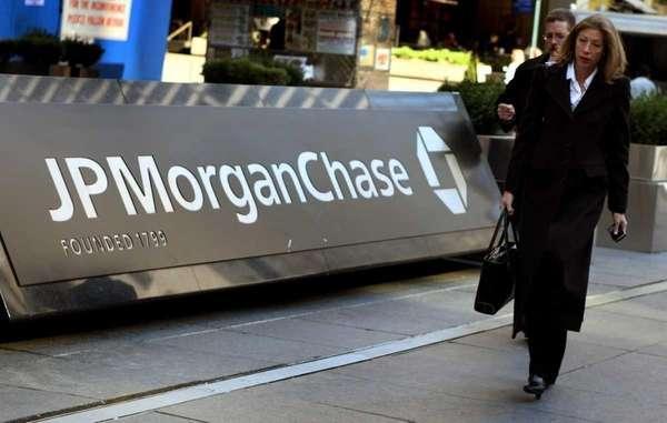 Pedestrians walk past the JP Morgan Chase headquarters