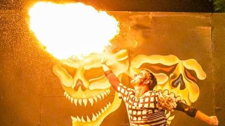 Zach Thomas as Laughing Jack, a fire performer