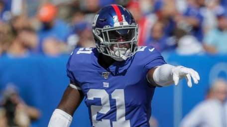 Giants safety Jabrill Peppers signals to his fellow