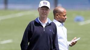 Giants co-owner John Mara, left, and general manager