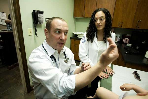 First-year Hofstra medical student Christina Scelfo observes as