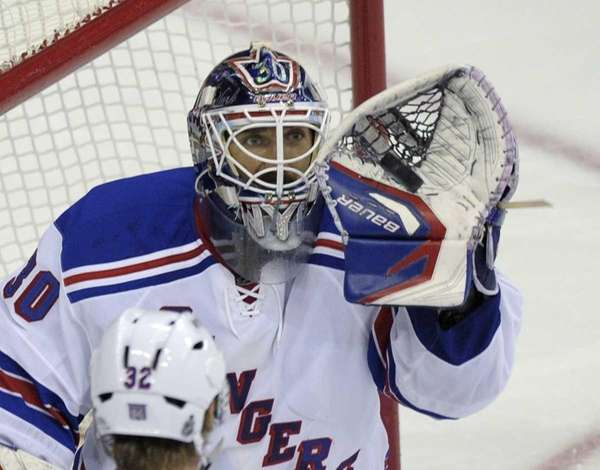 New York Rangers goalie Henrik Lundqvist catches a