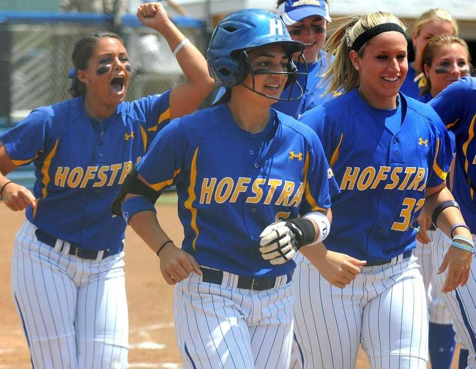 Hofstra University's Tori Rocha (wearing helmet) heads back