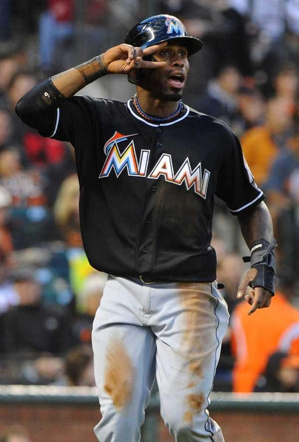 Jose Reyes #7 of the Miami Marlins salutes