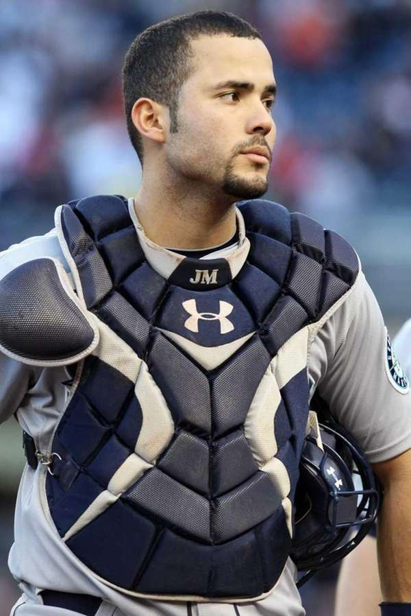 Jesus Montero of the Seattle Mariners looks on