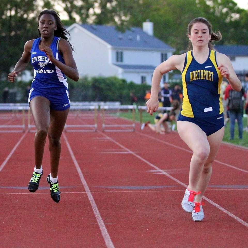 Northport's Stephanie Quinn (right) pulls away for the