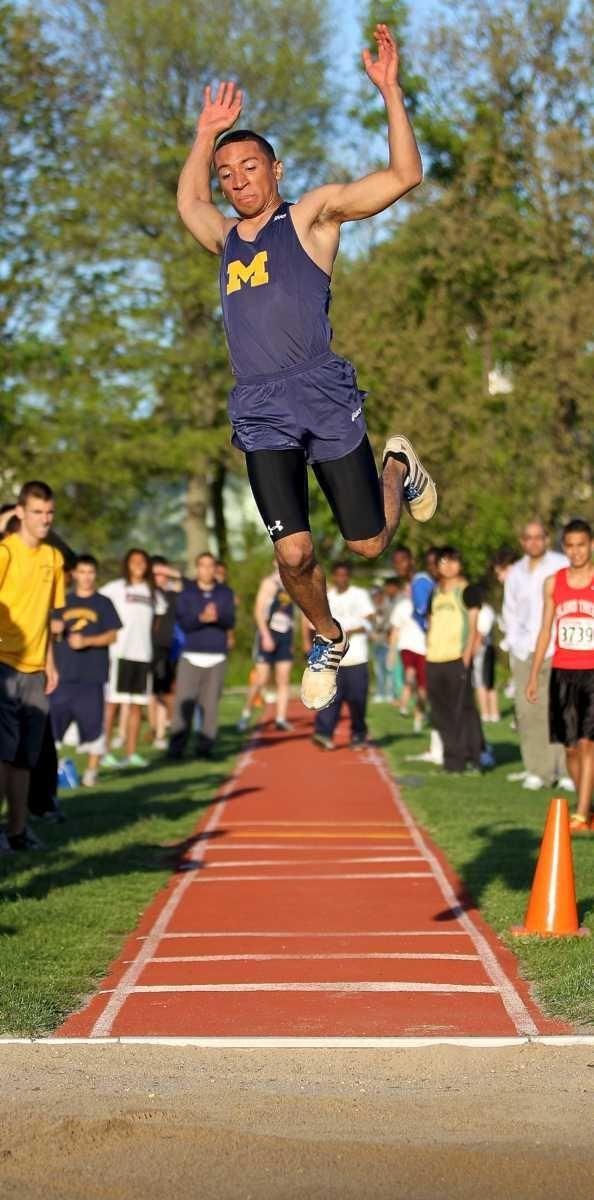 Massapequa's Joe Caraciolo jumps during his third attempt
