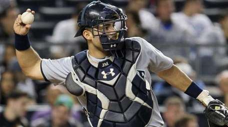 Jesus Montero of the Seattle Mariners throws the