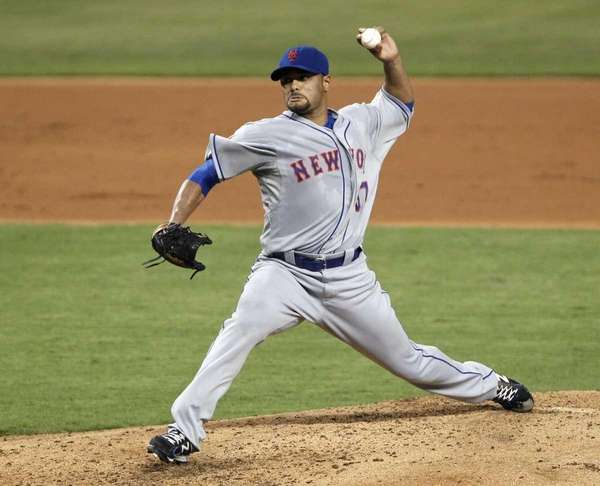 Johan Santana delivers a pitch. (May 11, 2012)