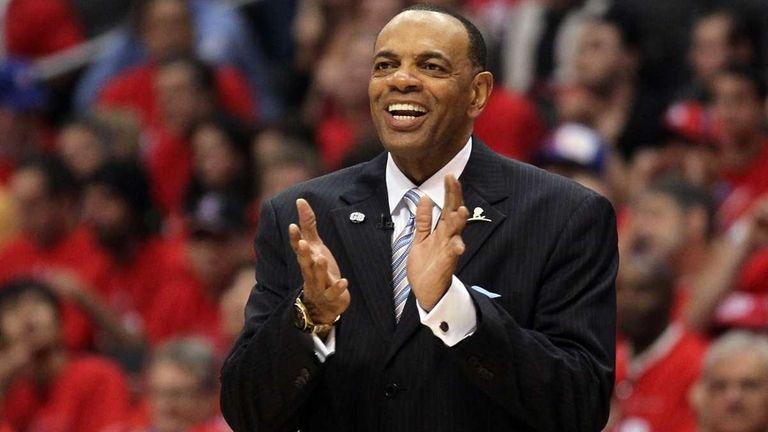 Memphis Grizzlies head coach Lionel Hollins cheers on