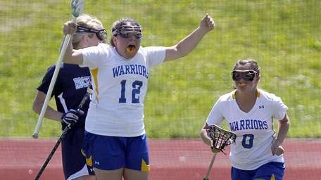 Comsewogue's Rachel Markowitz (12) reacts after scoring the
