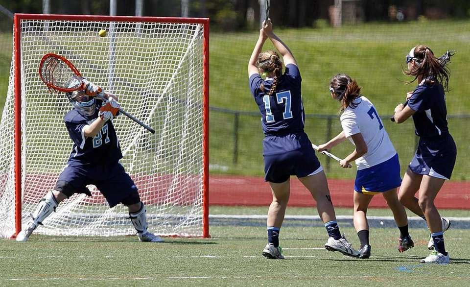 Comsewogue's Jordan Cassella (7) shoots and scores during
