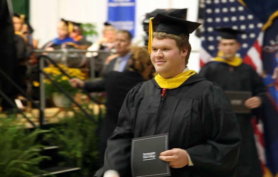 Evan Kisseloff, 21, of Oceanside, walks with a