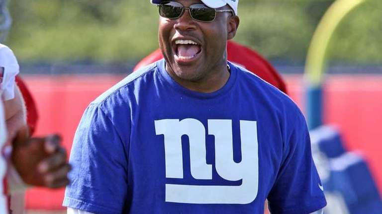 Defensive Coordinator Perry Fewell cheers an interception at