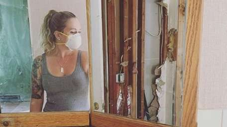 Corinne Scalici doing demolition in her Ronkonkoma home.