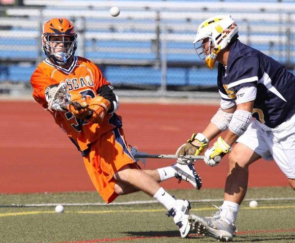 Nassau CC's James O'Boyle, left, passes as he