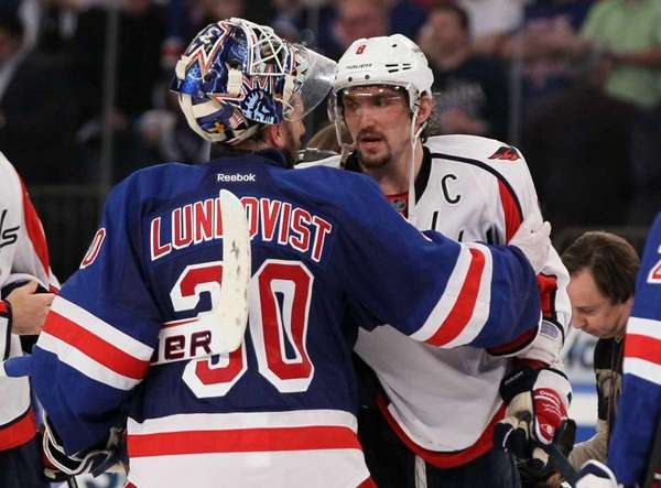 Henrik Lundqvist and Alex Ovechkin #8 of the