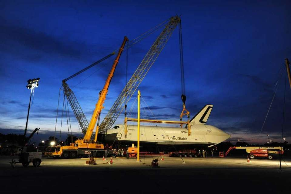 The shuttle Enterprise is hoisted from the jumbo