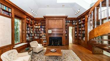 The library inside a Sands Point home listed