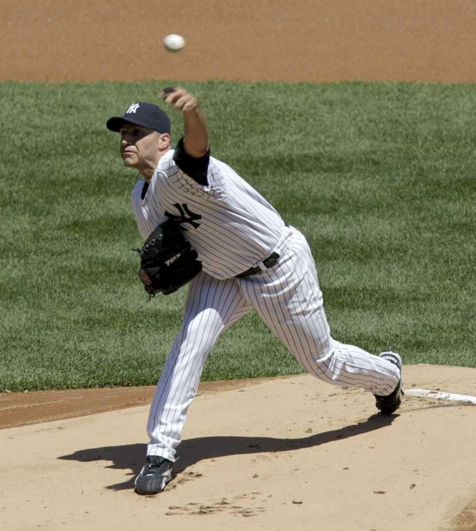 New York Yankees starting pitcher Andy Pettitte throws