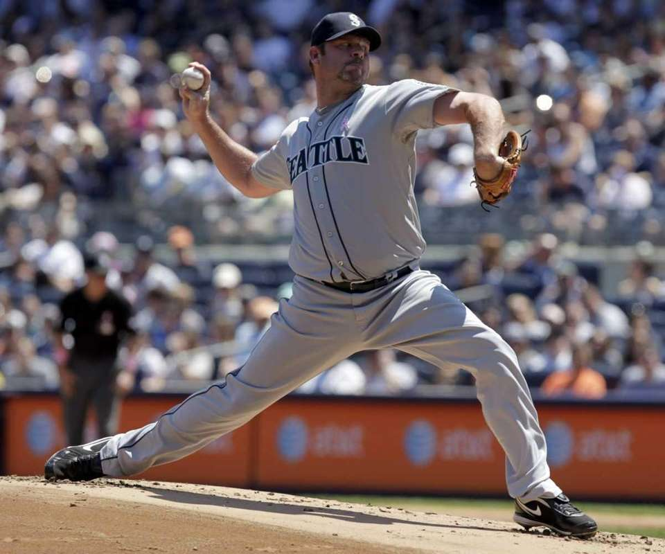 Seattle Mariners starting pitcher Kevin Millwood throws during