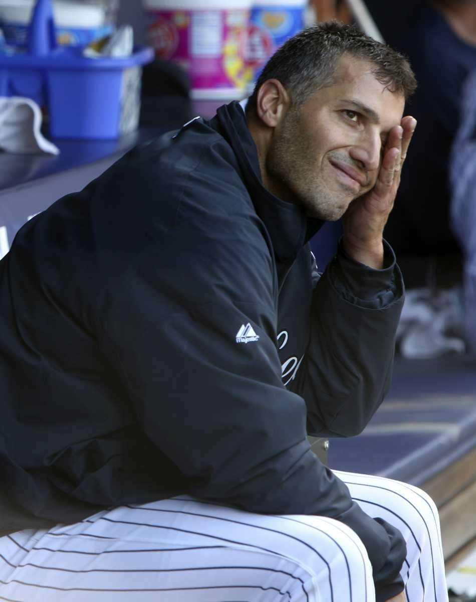 Yankees starting pitcher Andy Pettitte wipes his face