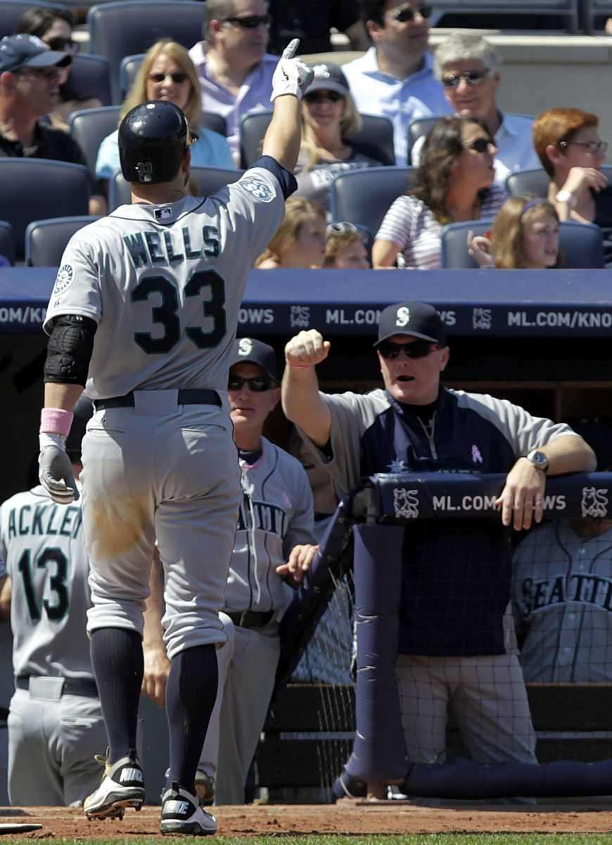 Seattle Mariners' Casper Wells (33) celebrates as he
