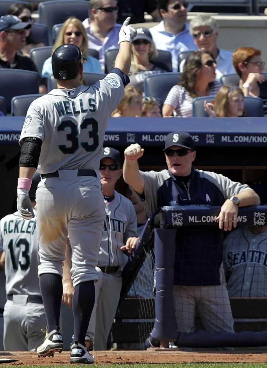 Seattle Mariners' Casper Wells (33) celebrates as he
