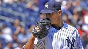 Andy Pettitte looks in for the sign as