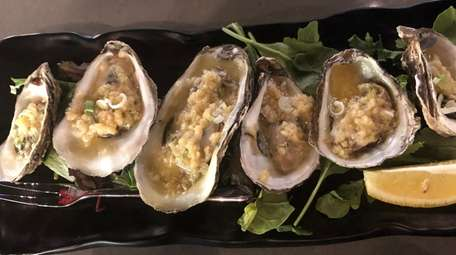 Grilled oysters at Cajun Claws, which has brought