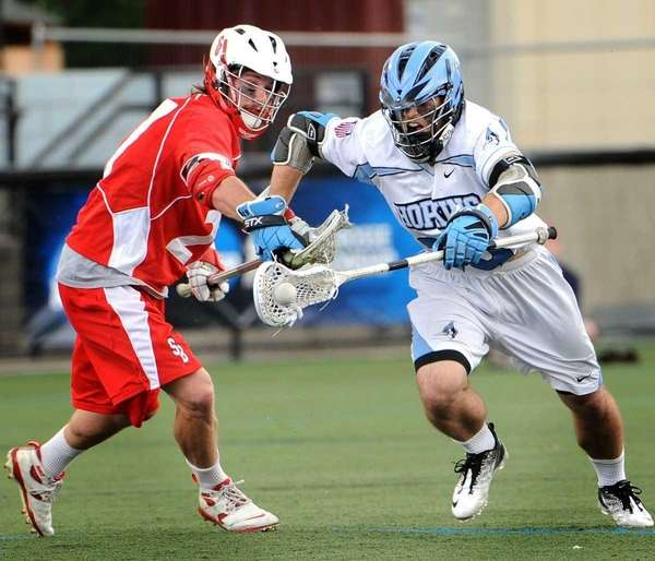 Hopkins player, Mike Poppleton, right, charges after the