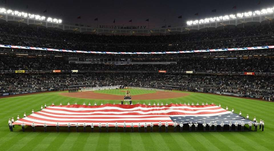 The American Flag is displayed on the field