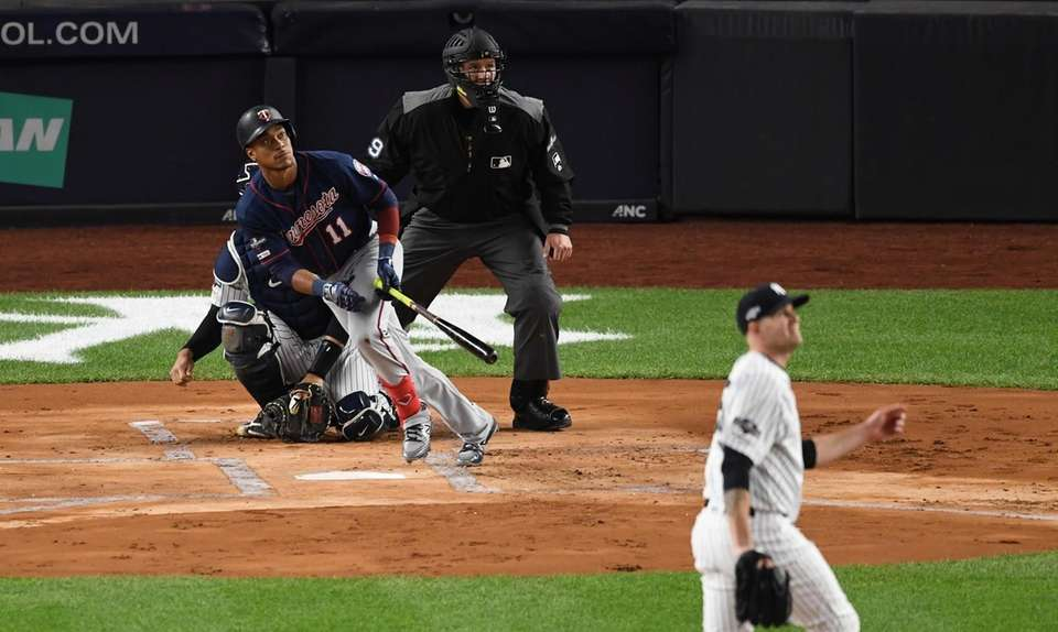 Minnesota Twins' Jorge Polanco watches the flight of