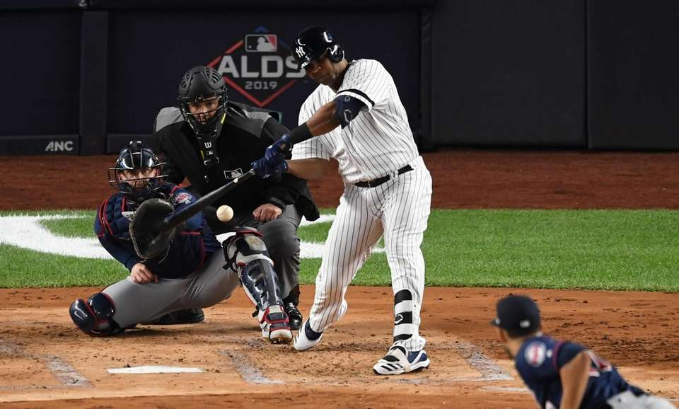 New York Yankees designated hitter Edwin Encarnacion doubles