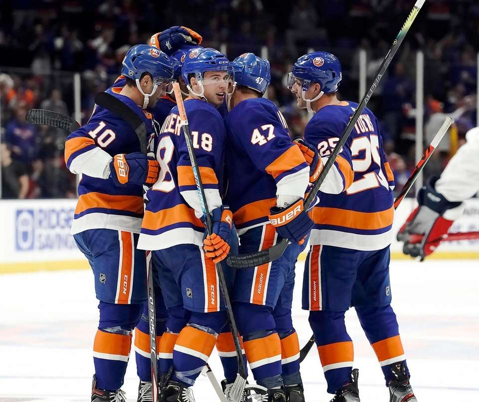 Islander celebrate with New York Islanders defenseman Devon