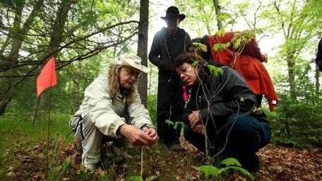 Naturalist Virginia Dankel points out to participants John