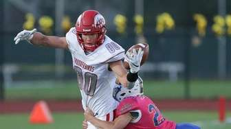 Connetquot's Cole Bunicci (80) tries to grab a
