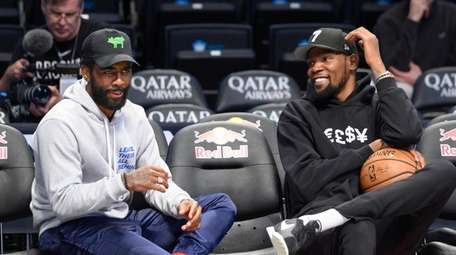 Brooklyn Nets guard Kyrie Irving (left) and forward
