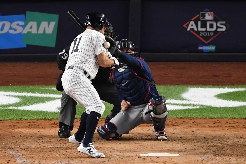 New York Yankees' Brett Gardner is hit by