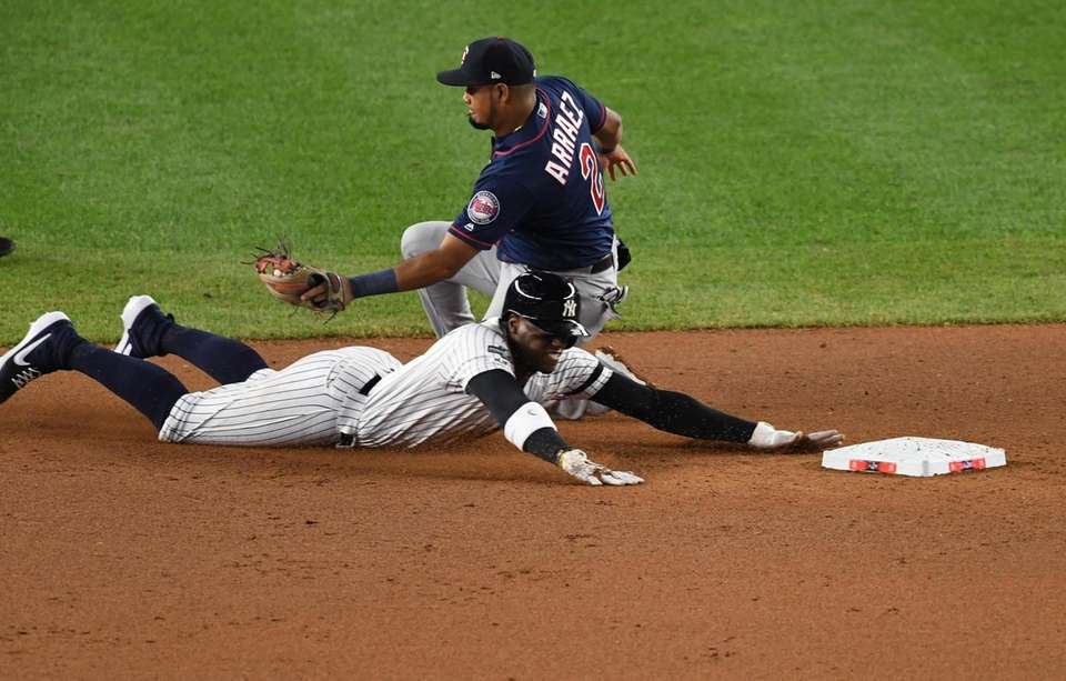 New York Yankees' Cameron Maybin steals second base