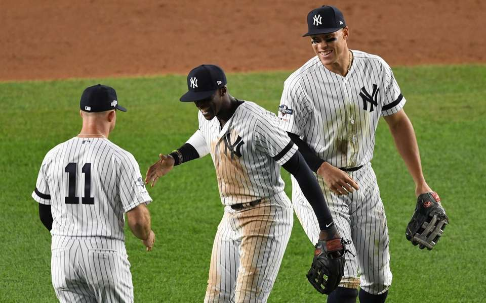New York Yankees' Aaron Judge, left, Cameron Maybin