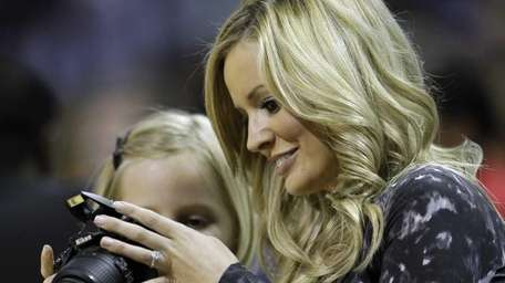 Emily Maynard, right, looks at photos with her