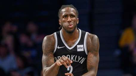 Taurean Prince of the Nets reacts after scoring