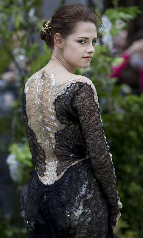Kristen Stewart poses for the media at the