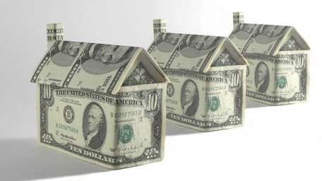 Home prices continued their slide in April, a