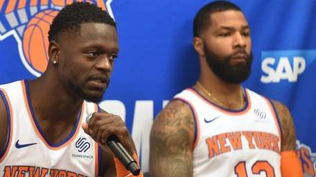 Julius Randle of the Knicks, left, speaks with