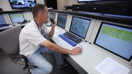 Tim McKell, a control center operator, monitors water