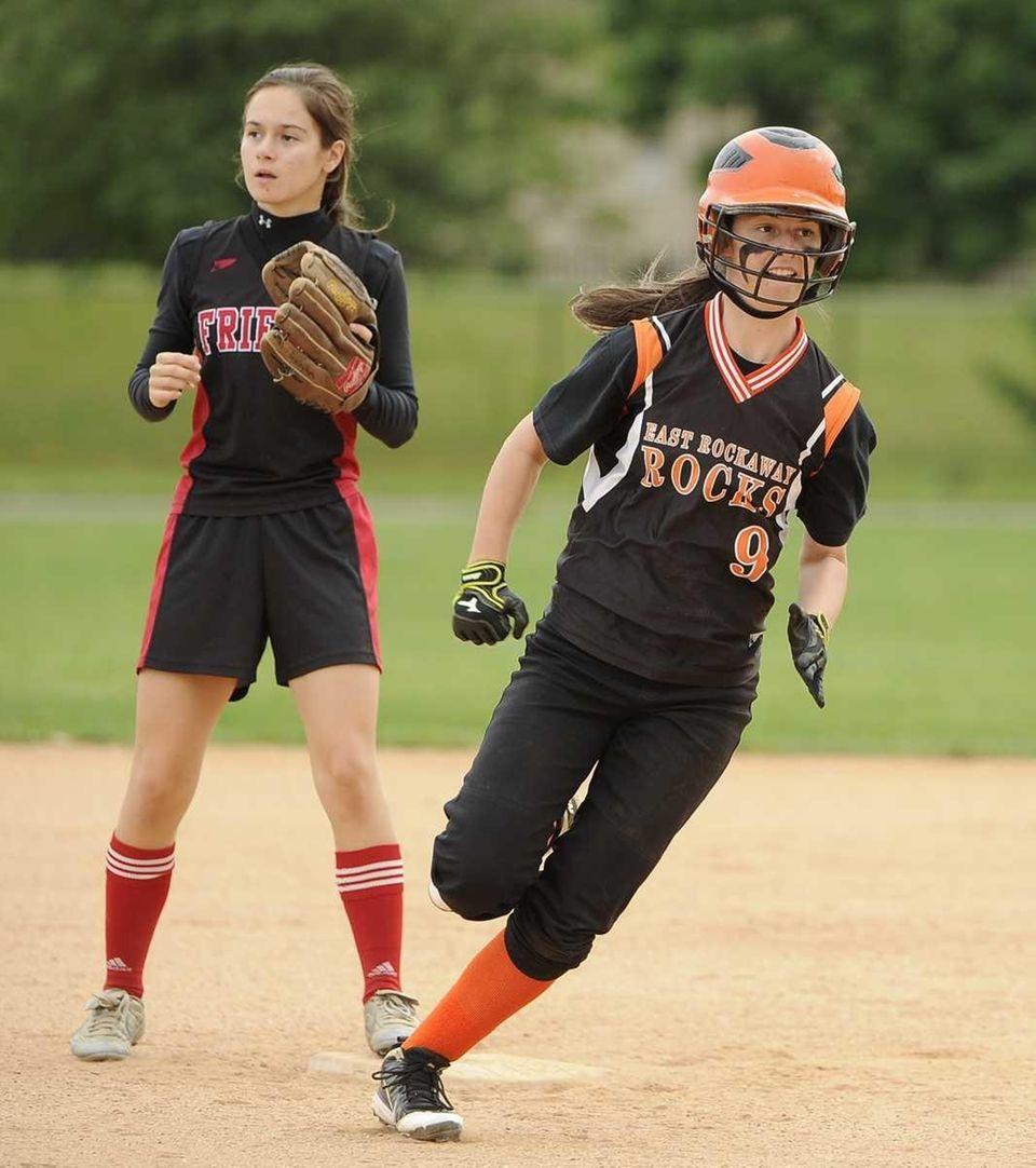 East Rockaway's Jessica Depultski rounds third base in