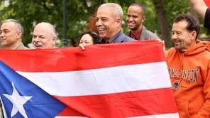 Holding a Puerto Rican flag, supporters of the