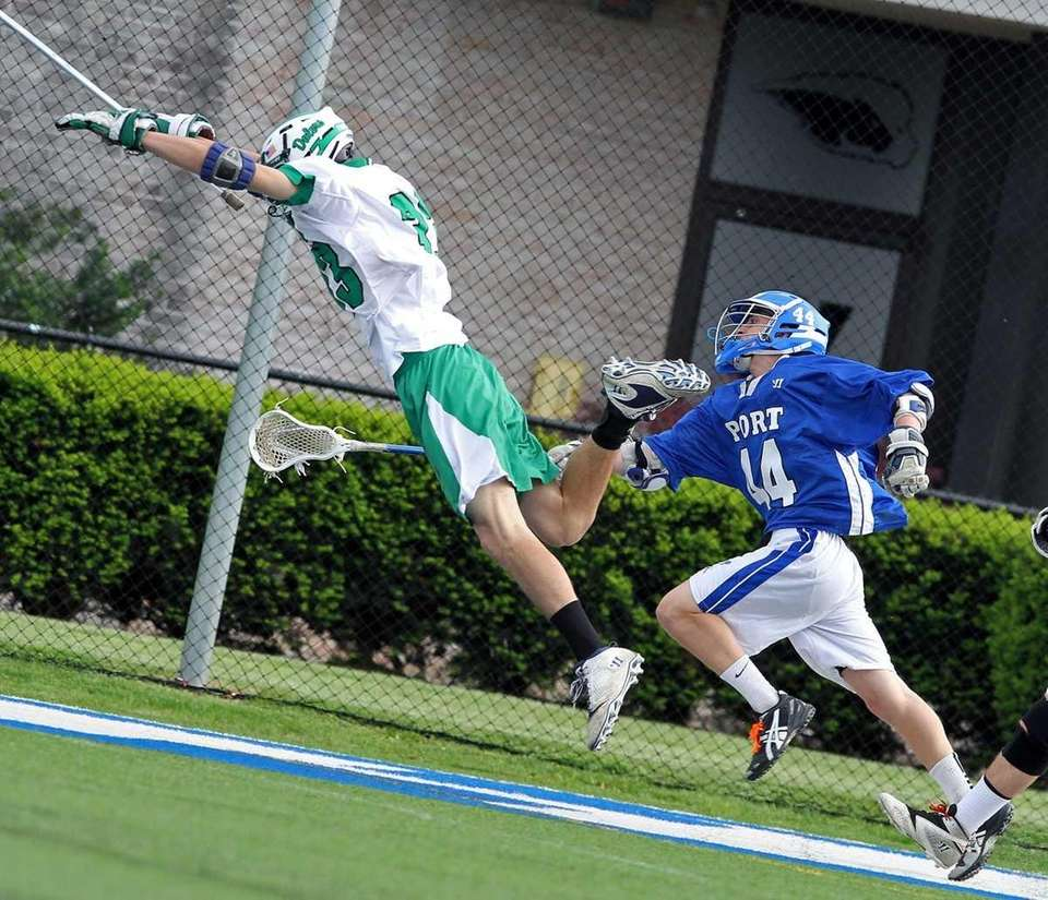 Farmingdale's Matt DiCarlo launches himself to get to